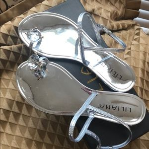 New silver jelly sandals